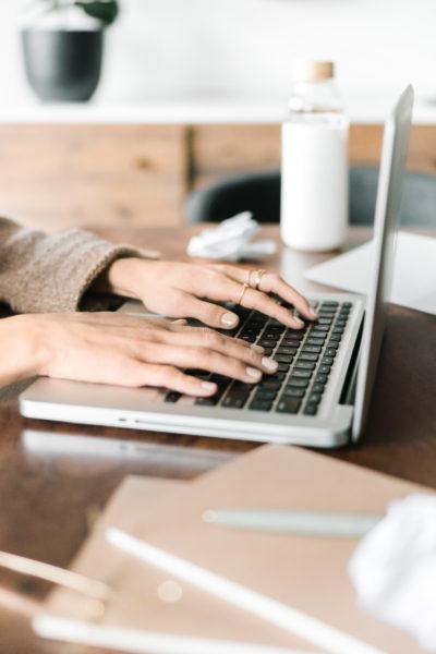 girl-sitting-at-laptop-system-envy